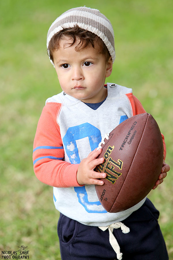 outdoor toddler portrait with football in los angeles