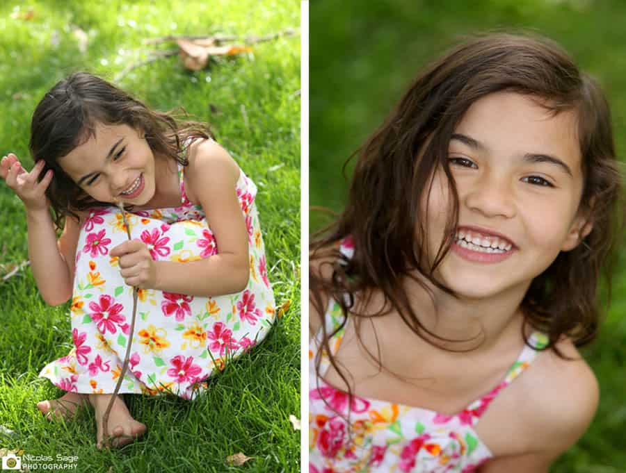 girl laughing sitting in grass