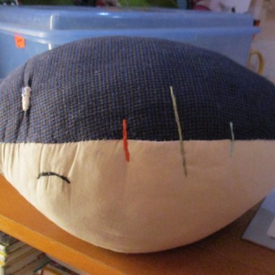 football pillow: sad face