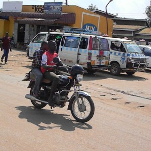 The local taxis in one shot: boda boda (motorcycle) and mutatu (mini bus)