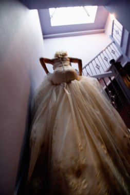 clift wedding san francisco photographer nicole caldwell bride walking on stairs