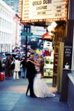 clift wedding san francisco photographer nicole caldwell bride and groom under gold dust lunge