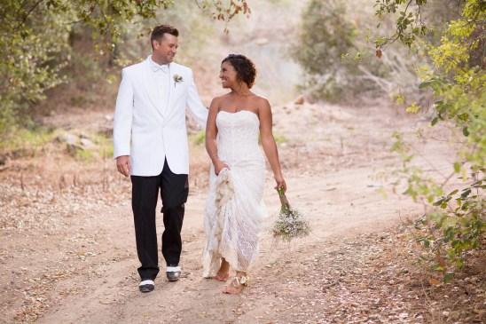 temecula creek inn weddings stonehouse ceremony brie and groom walking