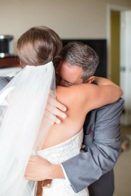 French Estate wedding photographer orange father of bride hugs