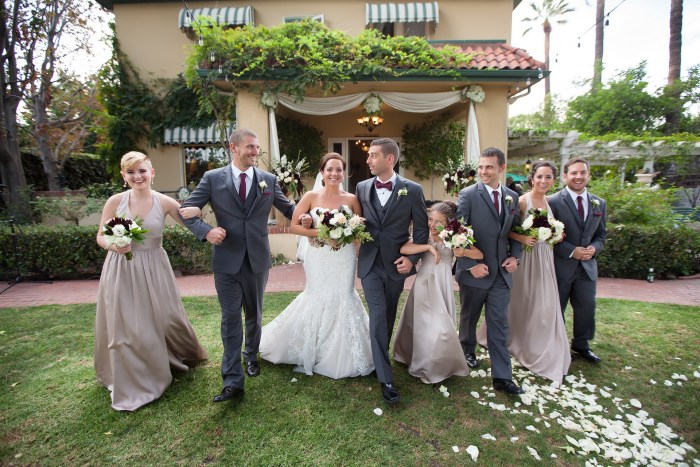 French Estate wedding photographer orange bridal party walking