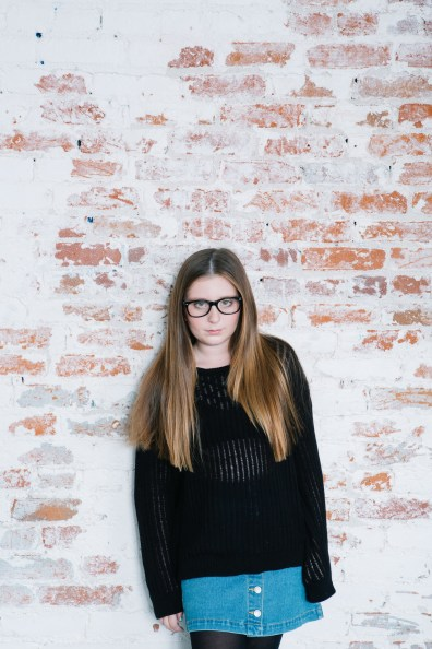 family photography ideas in the studio nicole caldwell brick backdrop 04