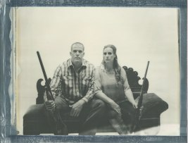 engagement photos in orange county studio 8 x 10 film polaroid impossible couple with guns
