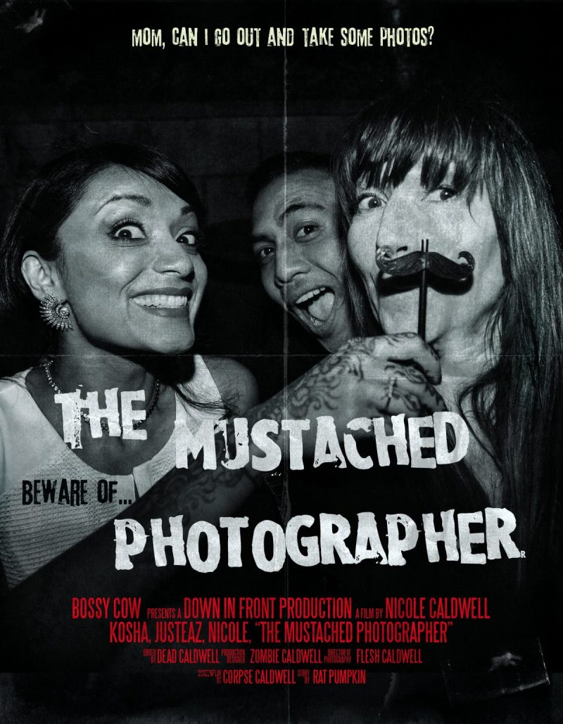 MUSTACHED PHOTOGRAPHER
