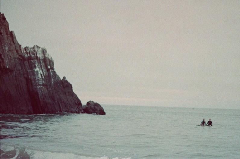 surf couple engagement photos on beach film ideas
