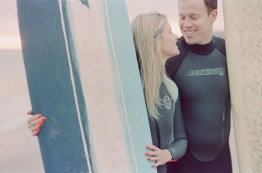 surf couple engagement photos on beach film crystal cove