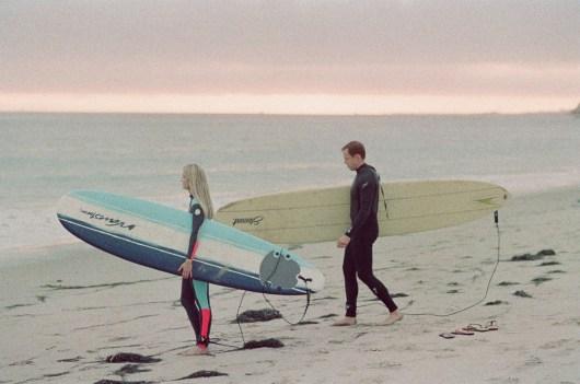surf couple engagement photos on beach 35mm film
