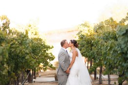 artistic temecula wedding photographer churon winery bride and groom in vineyard