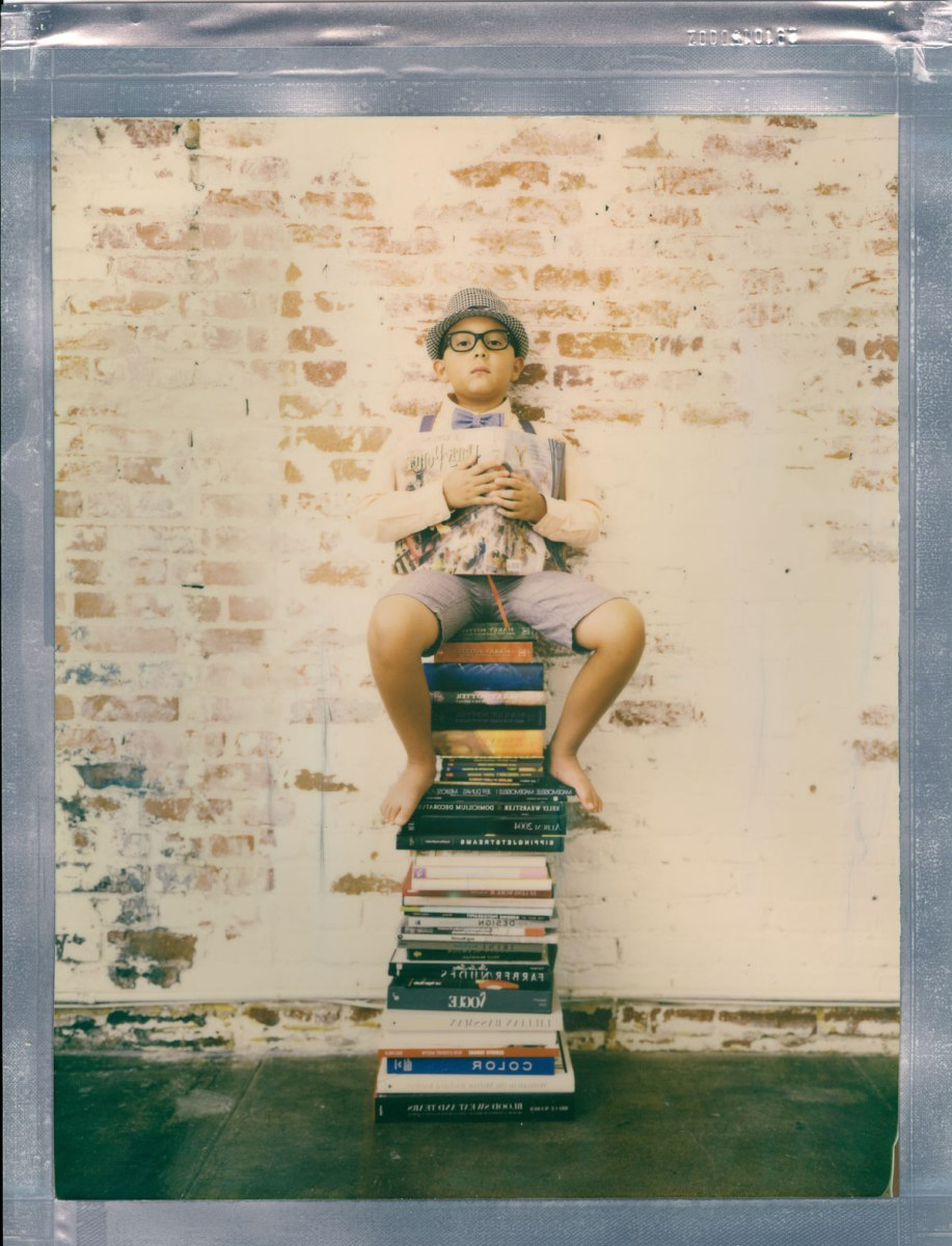 8 x 10 bookworm boy on book color polaroid impossible film