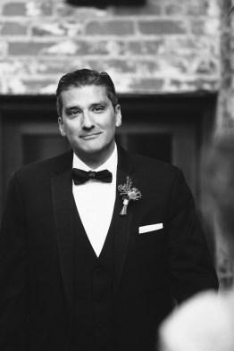 first look carondelet house wedding groom