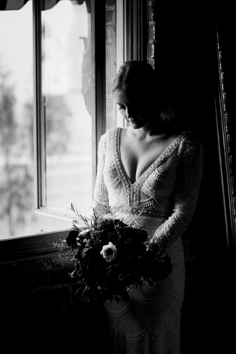 bride in window in bridal suite carondelet house