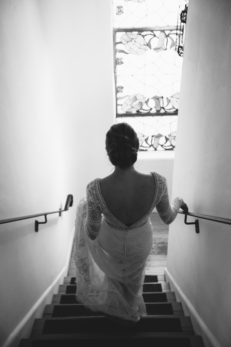 bride walking downstairs carondelet house