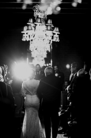 bride walking down aisle carondelet house