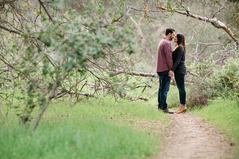 orange county engagement photographer park couple embracing