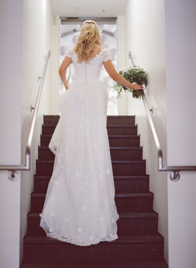 seven degrees wedding photographer nicole caldwell who uses film cinestill bride on stairs