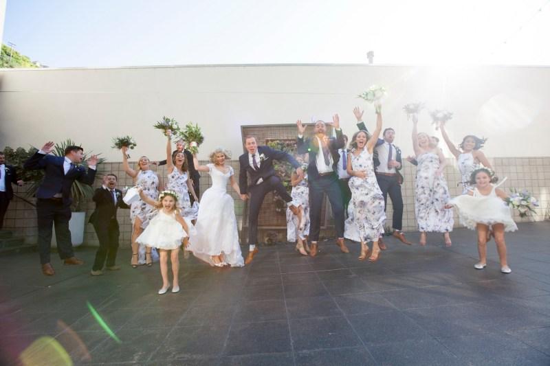bridal party jump laguna beach wedding venue seven degrees photographer nicole caldwell