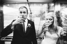 bride and groom in elevator with martini laguna beach wedding venue seven degrees photographer nicole caldwell