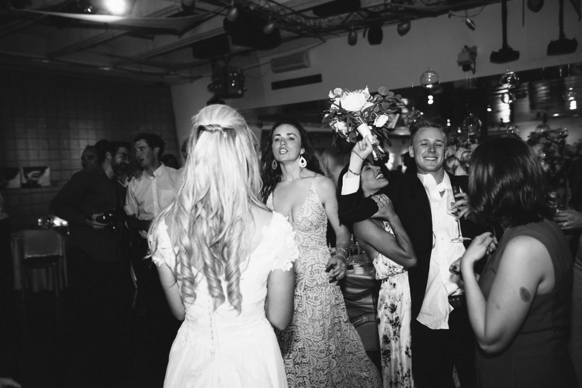 laguna beach wedding venue seven degrees photographer nicole caldwell bouquet toss