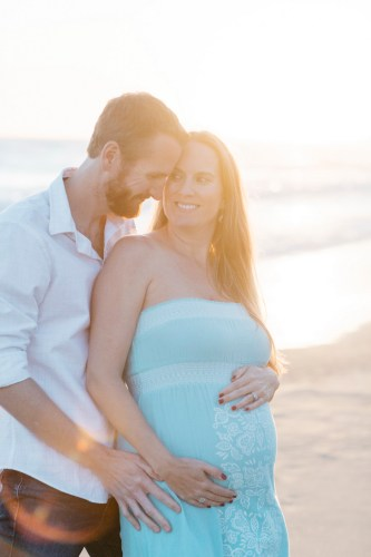 couple pose laguna beach maternity photographer nicole caldwell crystal cove