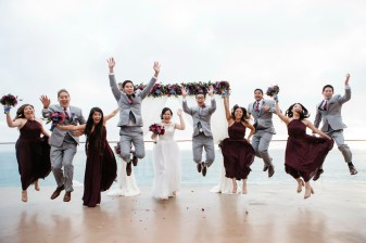 surf and sand resort wedding photographer nicole caldwell bridal party jumping shot