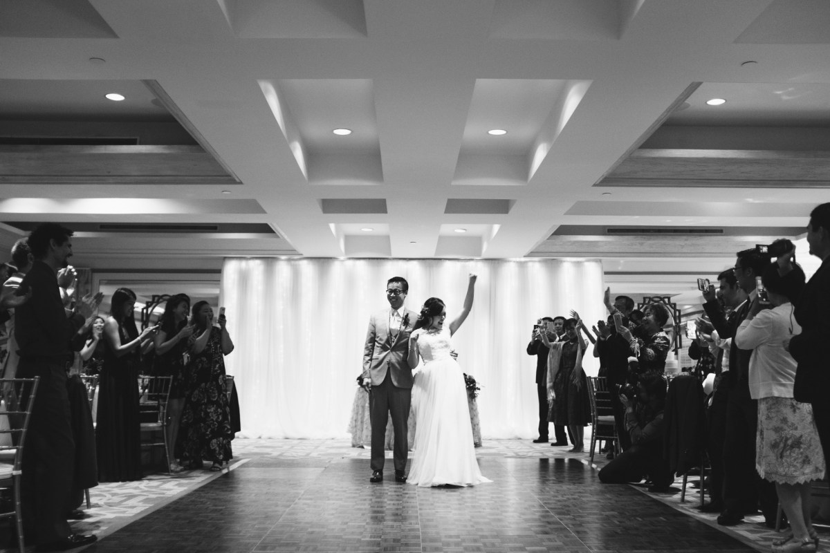 surf and sand resort wedding photographer nicole caldwell grand entrance