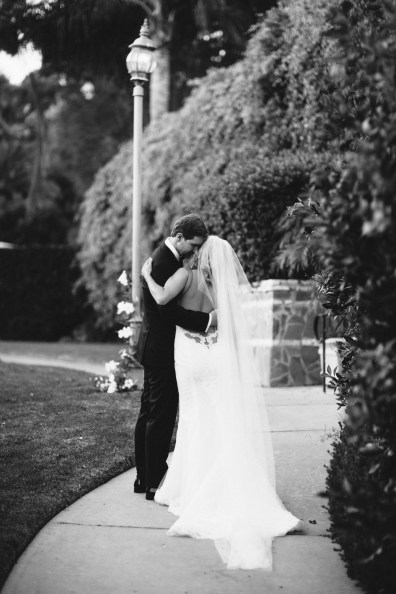 bride and groom embrace bel air bay club wedding palos verdes