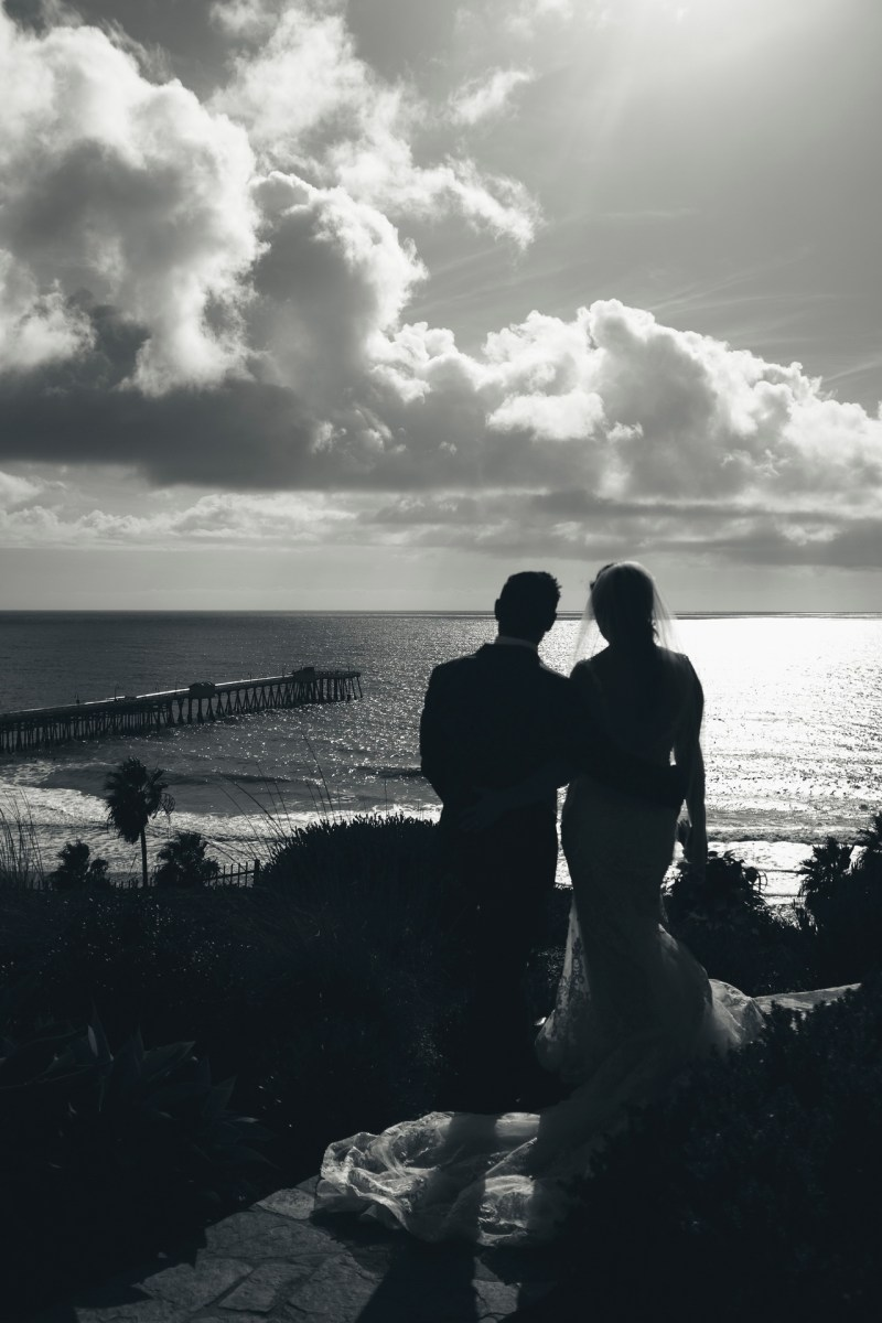 casa romantica san clemente wedding photographer artistic couple looking out at water