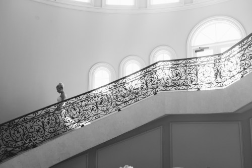 bride walking downstairs Monarch beach resort wedding photographer nicole caldwell