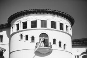bride and groom on balcony Monarch beach resort wedding photographer nicole caldwell