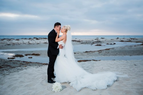 bride and groom on beach Monarch beach resort wedding photographer nicole caldwell