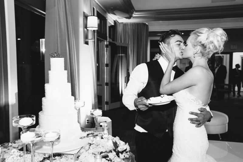 bride and groom cutting cake Monarch beach resort wedding photographer nicole caldwell