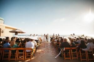 ceremony surf and sand resort wedding photographer nicole caldwell