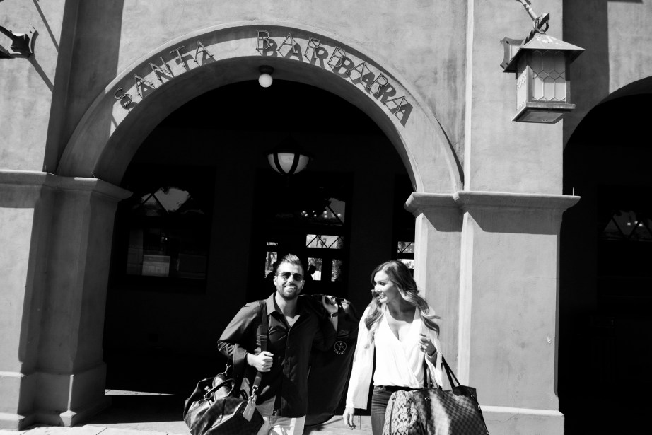 santa barbara couple walking attrain station paparrazzi style nicole cadwell engagement photos