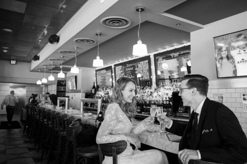 washington dc wedding and elopement by nicole caldwell bride and groom drikning champagne at bar