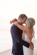 bride and groom embracing wedding photos surf and sand resort laguna beach