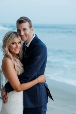 bride nad groom hug on beach wedding photos surf and sand resort laguna beach
