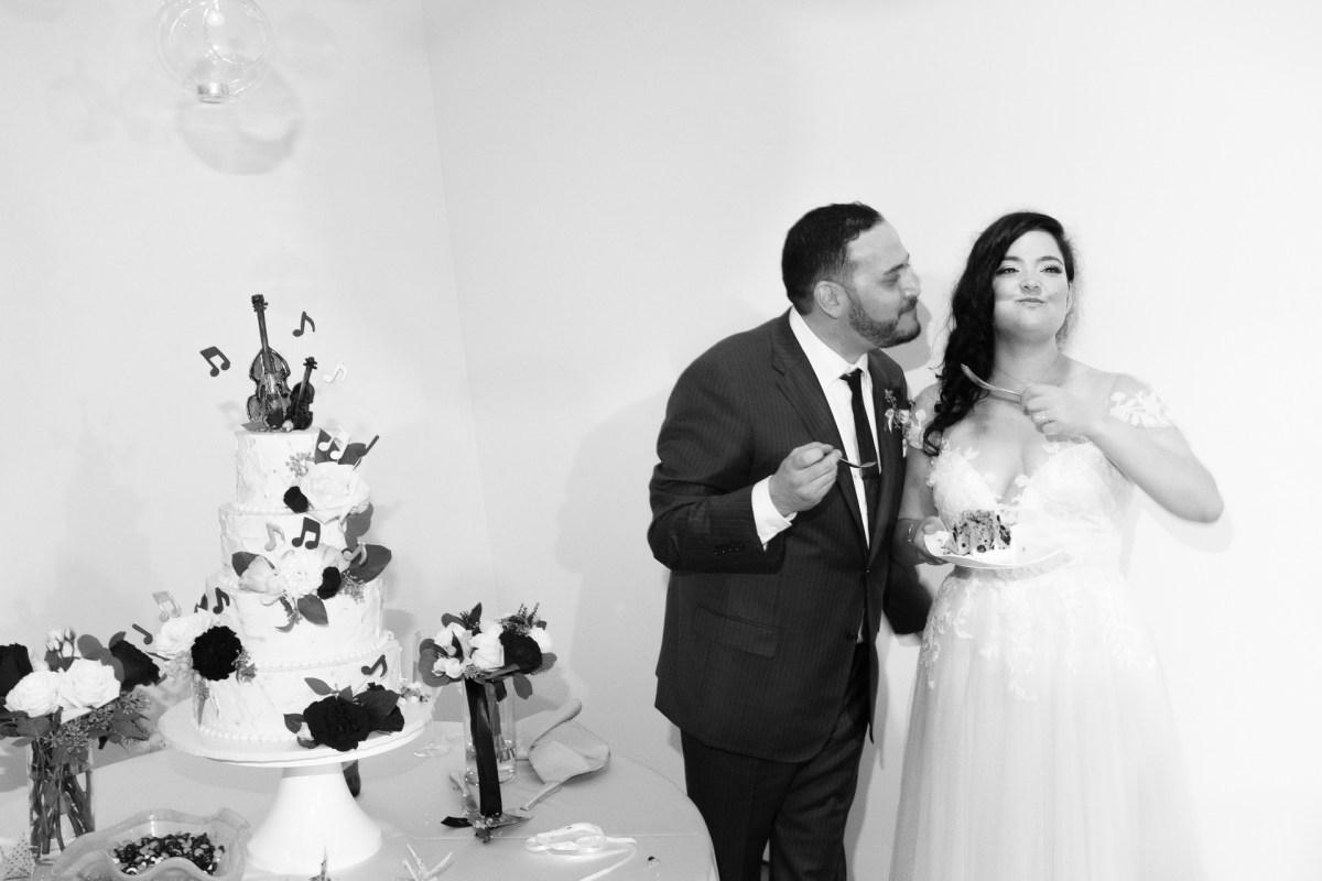 bride and groom cake cutting seven degrees wedding photographer laguna beach