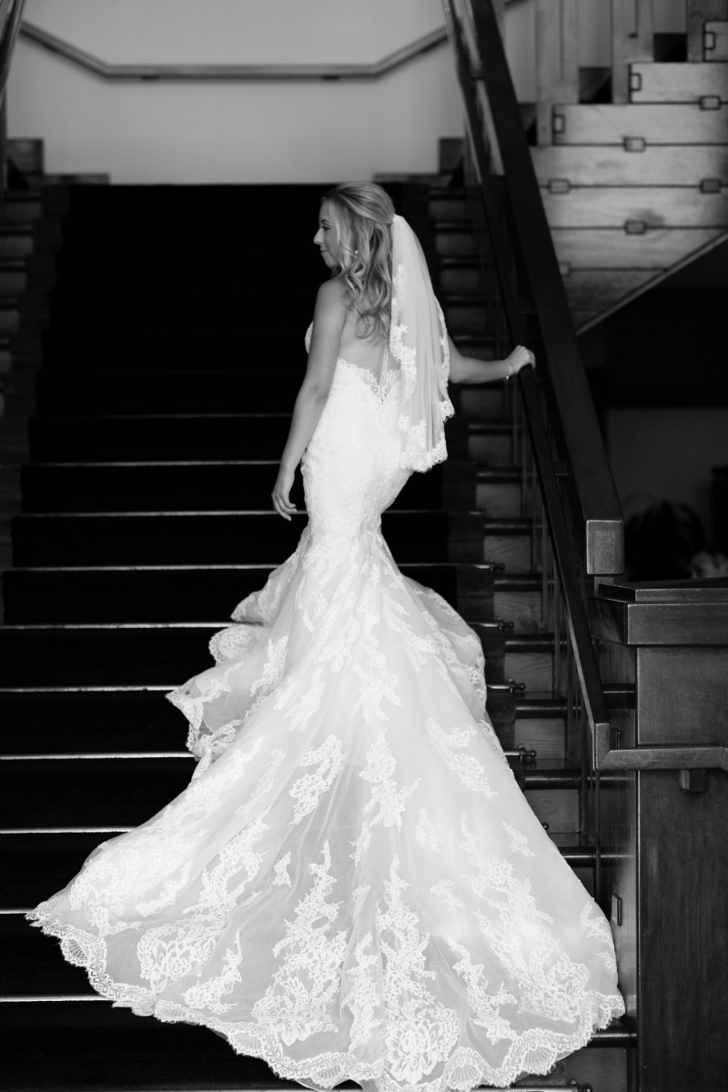 bride and stairs Coto De Caza Raquet and golf club weddings by nicole caldwell
