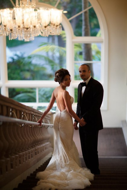 bride and groom on stairs ritz carlton laguna niguel