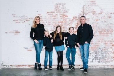 family photography ideas in the studio nicole caldwell brick backdrop 07