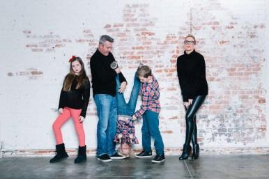 family photography ideas in the studio nicole caldwell brick backdrop 17