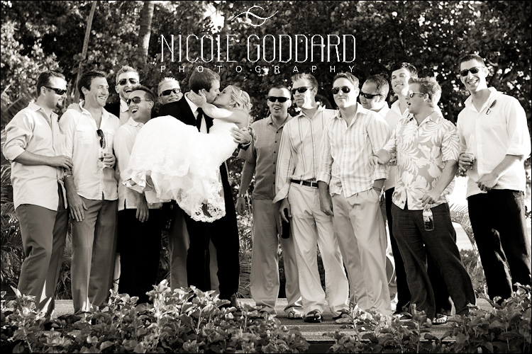 052_090309_nicolegoddard_mg_6282_group of bride and men