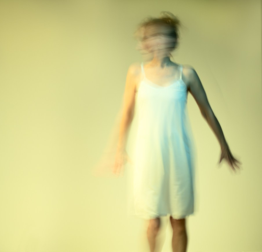 Artphoto anxious woman in white dress, yellow background