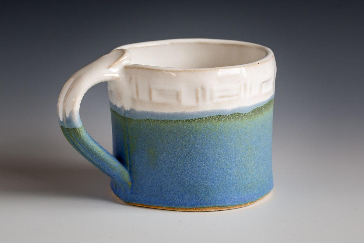 This ceramic mug was photographed on a black/white graduated paper backdrop.