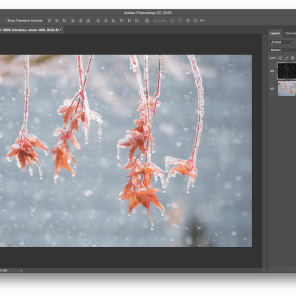 "Step 4: In the Layers panel, change the blending mode of the snow overlay layer to ""Screen"""