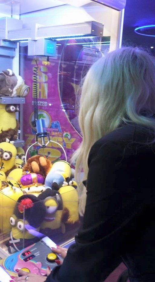 Nicole Williams Tries To Win A Minion At Bourmouth Amusements